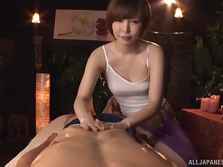 Short haired Japanese Satomi Yuria massages a cock with say no to pussy