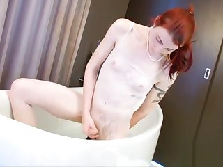 Redhead shemale fucks the brush juicy wet ass with big dildo