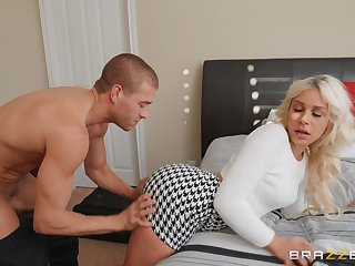 Tow-headed Carmen Caliente moves her dress for a long and strong penis