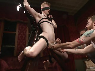 Gay males share make an issue of dick in total BDSM gay play