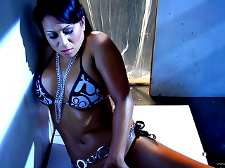 Kayme Kai with fake chest ill feeling and teasing her twat in a solo close up