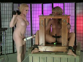 Blonde chick tied up and tortured with a couple of large dildos