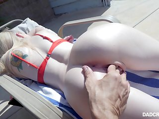 Sunbathing stepdaughter Lexi Lore gives a deepthroat blowjob by chum around with annoy poolside