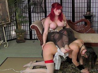Ample breasted mistress adjacent to corset spanks and fucks submissive slut