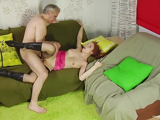Older gent taps into a sultry redhead's bustling sexuality