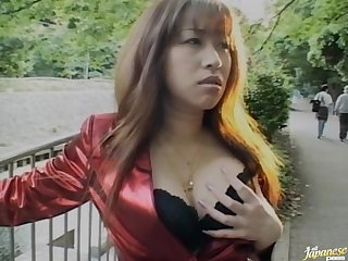 Brunette Japanese Mirai Hirooka teases and gives a handjob