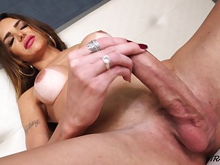 Sex-crazy transsexual Jennifer Satine is jacking elsewhere hard and beamy cock