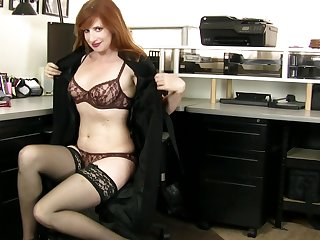 Redhead amateur Amber Dawn pleasures her pussy with fingers
